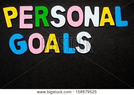 """Colorful wooden letters forming the phrase """"personal goals"""""""