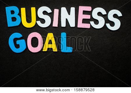 """Colorful wooden letters forming the phrase """"business goal"""""""