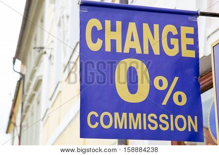 Outdoor blue  banner with amount of the fee commission information of foreign currency exchange street office