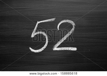 number fifty two enumeration written with a chalk on the blackboard