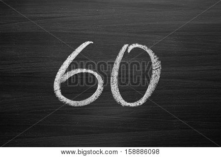 number sixty enumeration written with a chalk on the blackboard poster