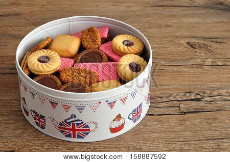 A tin filled with a variety of biscuits