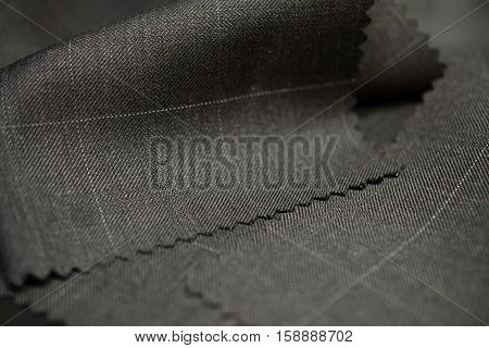 close up texture brown with white line fabric of suit photo shoot by depth of field for object