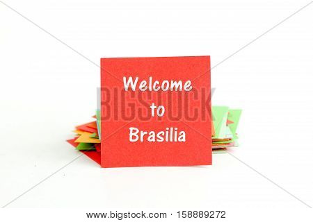 picture of a red note paper with text welcome to brasilia