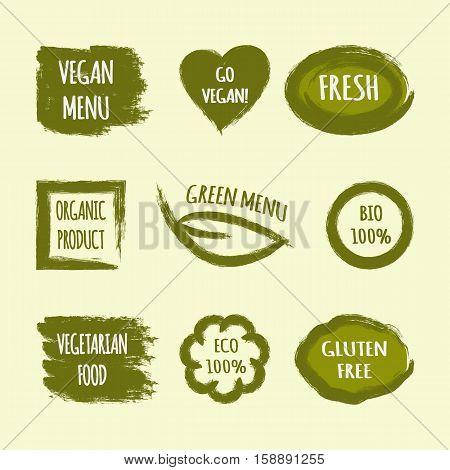 Set of green grunge labels with text Go Vegan Fresh Green Menu Organic Product BIO 100% Vegetarian Food ECO Gluten Free. Heart leaf circle square frame brush stroke.