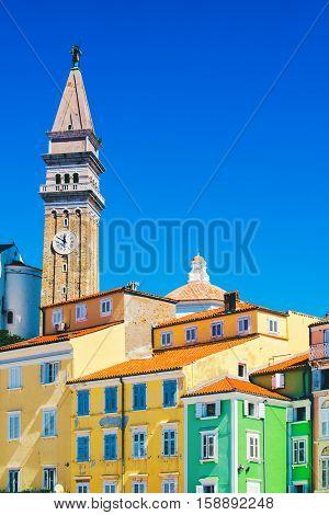 Bell clock tower and colorful facades at Tartini square in Piran Istria Slovenia