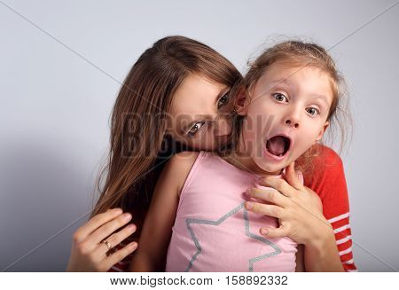 Angry Emotional Young Mother Wanting To Bite Her Naughty Capricious Daughter With Screaming Nervous