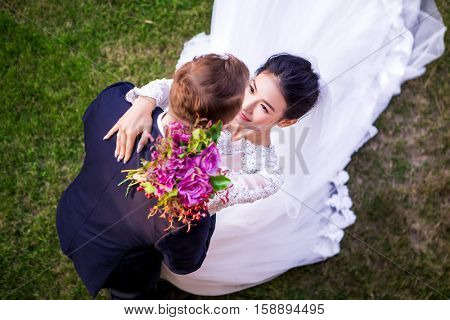 High angle view of romantic wedding couple on grassy field