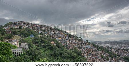 Skyline view of Rio de Janeiro Slum, favela Morro dos Prazeres on mountains, Brazil