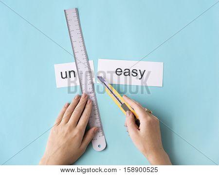 poster of Uneasy Uncomfortable Hands Cut Split Word Concept