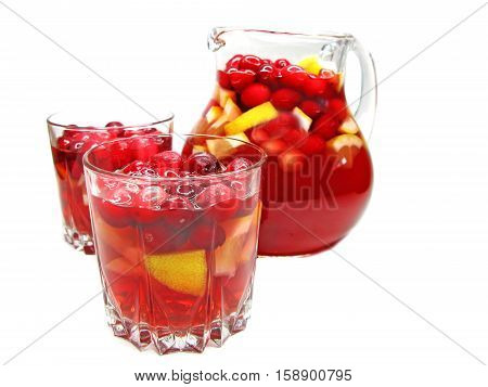 fruit cruchon cocktail punch in jug and glasses with ice and fruit
