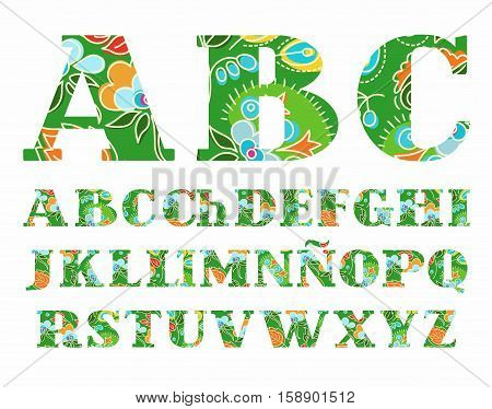 Summer, the Spanish alphabet, capital letter, vector, font, color. The letters of the Spanish alphabet with serifs. Flowers and plants on a green background.