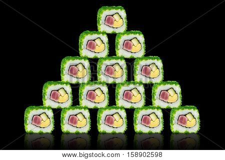 Sushi with tuna cheese and avocado in the form of a pyramid. On a black background with reflection.