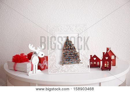 Handmade Christmas tree in photo frame on white table