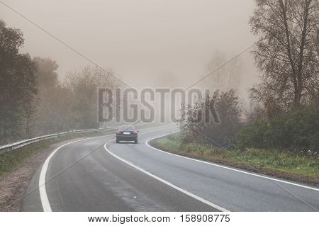 Foggy Road, Car Goes On Empty Highway