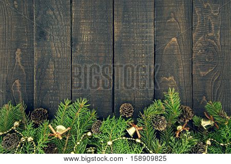 Composition With Decorated Christmas Tree On Dark Rustic Wooden Background With Copy Space For Text.