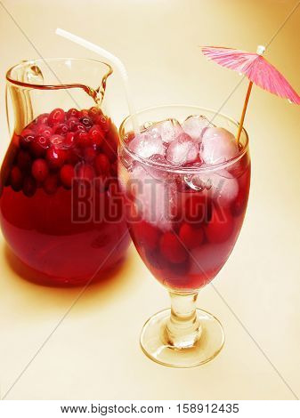 fruit cherry cocktail punch in jug with ice and fruit