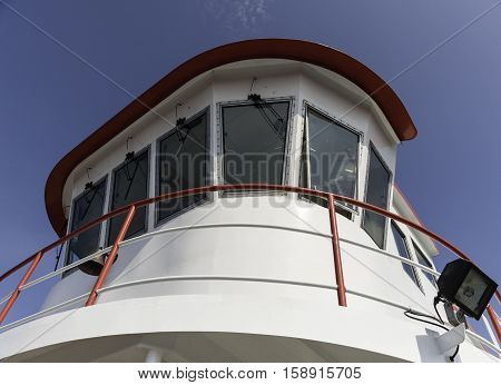Portland Maine USA - August 9 2009: Brightly painted ferry wheelhouse towers over bow of vessel