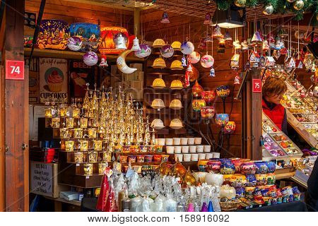 PRAGUE, CZECH REPUBLIC - DECEMBER 11, 2015: Wooden stall with decorations for winter holidays at traditional annual Christmas market taking place in december in Old Town of Prague.