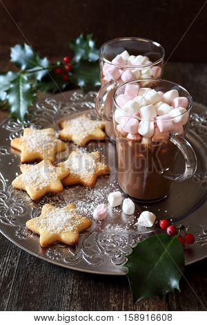 Homemade Christmas cookies and two cups of hot chocolate with marshmallow