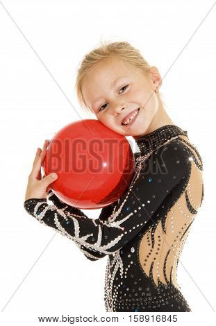 Beautiful girl gymnast doing exercise with a ball.