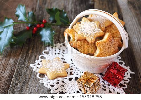 Homemade Christmas cookies in ceramic basket with festive decoration