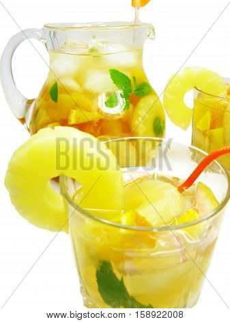 fruit juice cocktail punch in jug and glasses with ice and fruit