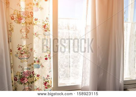 Curtains and window. Sunlight in the window. Meet new day. Feel warmth of home.