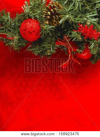 Decorated Christmas Fir Tree on red background