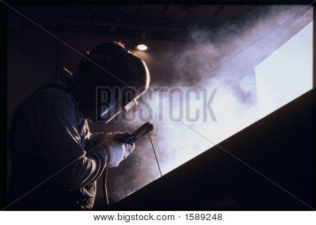 American welder at work making the
