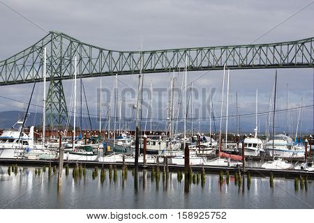 The view of Astoria town marina with Astoria-Megler Bridge behind (Oregon).