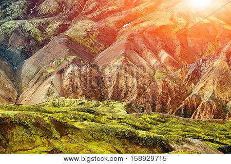 Valley National Park Landmannalaugar. On the gentle slopes of the mountains are snow fields and glaciers. Magnificent Iceland in the August