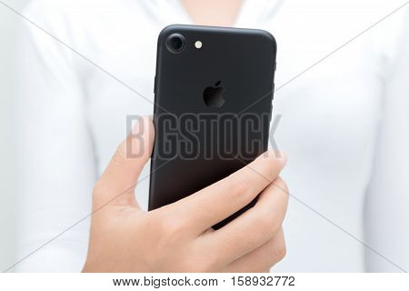 Bangkok Thailand - October 28 2016: Close-up woman hand hold iphone 7 showing backside iphone 7 is new smart phone by apple inc.