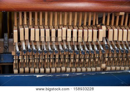 Detail of old piano frame with strings and hammers