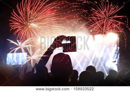cheering crowd and fireworks - New Year celebration concept