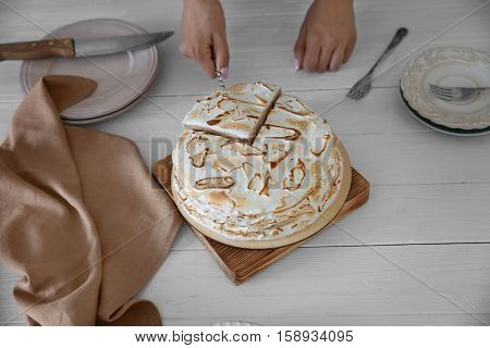 Female hand taking piece of delicious cake