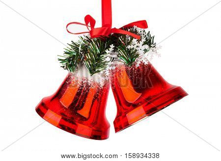 Christmas bells with a red bow isolated on white background