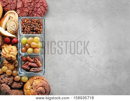Set of different products on color background