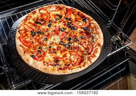 Appetizing pizza in the oven, Cooking in the oven.