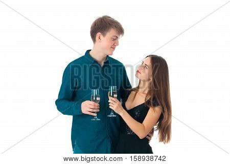 cute couple in love with two glasses of champagne in studio on white background