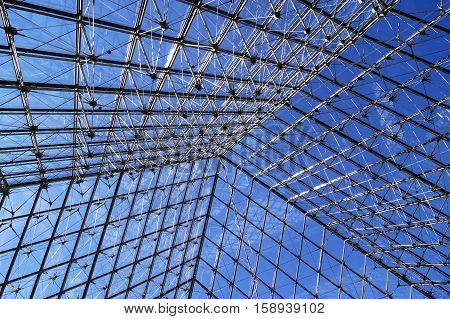 PARIS FRANCE - SEPTEMBER 28 2015: Glass pyramid at the Louvre the world's largest museum in Paris France