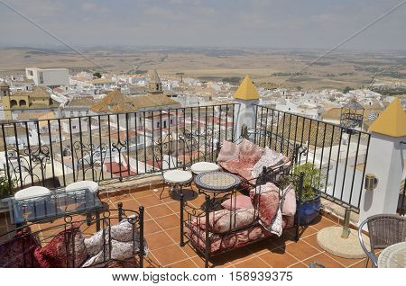 MEDINA SIDONIA, SPAIN - JULY 28, 2014: Terrace of restaurant with views to the village of Medina Sidonia a white town of the province of Cadiz Andalusia Spain