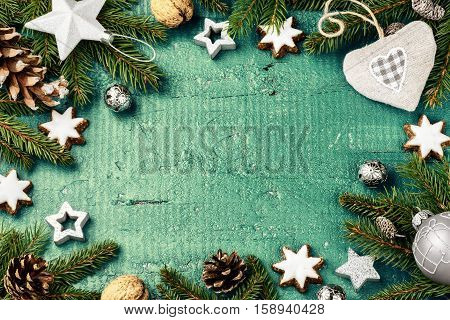 Christmas holiday frame with festive decorations over old blue wood. Christmas background with copy space