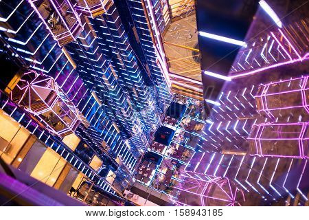 MOSCOW, RUSSIA - OCTOBER 01: Beautifully lit atrium Mall, the Elevator goes up, in Moscow on 1 October 2016