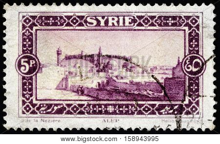 LUGA RUSSIA - NOVEMBER 29 2016: A stamp printed by SYRIA shows view of Aleppo - a city in Syria serving as the capital of the Aleppo Governorate circa 1925