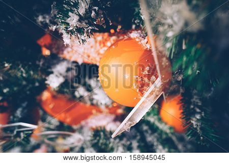 Christmas tree decoration closeup for background. New year firtree branch in snow, retro style blurry photography