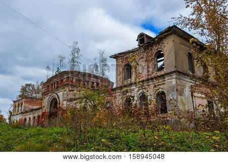 A derelict outbuilding to a dilapidated Church. The Village Of Rybinsk-Zaruch'ye. The complex is a dilapidated old Church building.