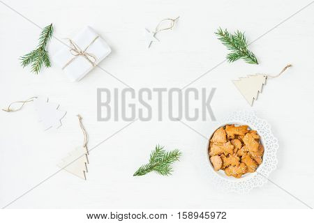 Christmas workspace. Gift fir branches christmas cookies. Flat lay top view