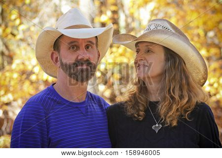A Portrait of a Married Couple with Autumn Leaves in the Background