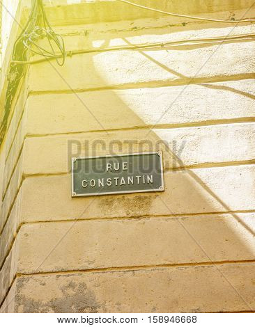 Sunny day over Rue Constantion or Constantin street sign seen in Aix-en-Provence France